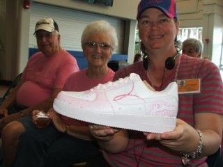 Anne holding one of Coach Butler's shoes