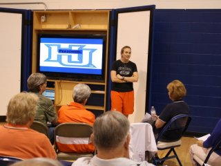 Coach speaking to BCC members