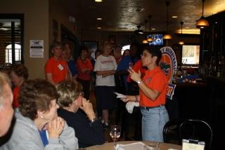 Miriam conducting trivia game at halftime