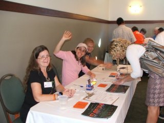 Robin, Jane and Dottie work the membership table