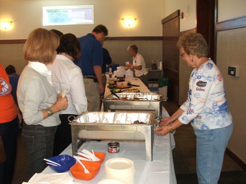 BCC member June assisting at the food table