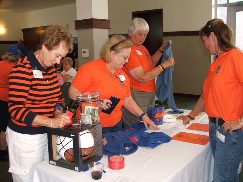 Members at the merchandise table