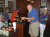 Cassie and Sue helping Bill and Betty with beverages.