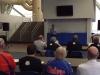 Members reviewing report as coach speaks